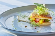 Sea bass fillet served on steamed vegetables and garlic puree, with extra virgin olive oil and baby leaves. For Tatoi Club