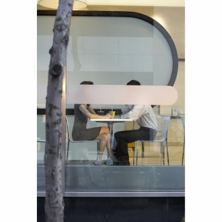 Obscured couple in cafe window