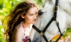 close up portrait of girl with white horse